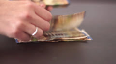 Female count money Stock Footage