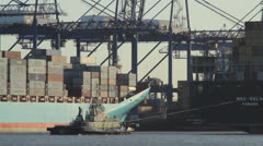 Tug pulling container ship. Stock Footage