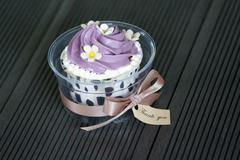 colorful cupcake with a thank you tag - stock photo