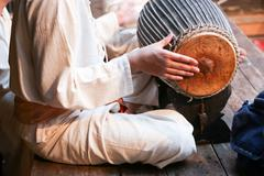 drummer in a traditional thai musical band - stock photo