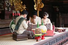 Bride and groom in traditional thai northen style wedding ceremony Stock Photos