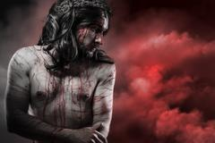 jesus christ over red cloudscape, calvary concept - stock photo