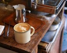 Beautiful coffee art in an enamel mug Stock Photos