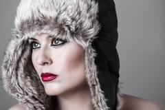 Sensual and sexy brunette with winter hat Stock Photos