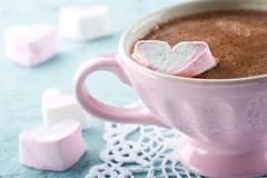 hot chocolate and a heart shaped marsmallow - stock photo