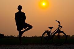 yoga with bicycle - stock photo