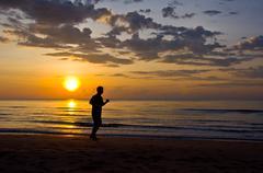 running on the beach - stock photo