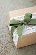 simple decorative gift box wrapped in brown eco paper and lace - stock photo