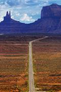 Digitally created image of a roadway leading to monument valley Stock Photos