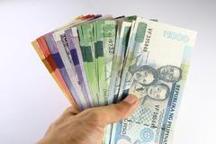 Philippine Peso Bills Held in Hand - stock photo