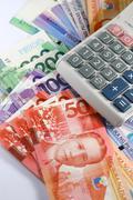Philippine Peso Bills and Calculator Stock Photos