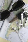 Map, Key, Sunglass and Ear Buds Stock Photos