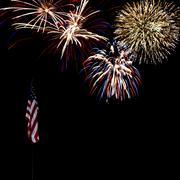 Fireworks over american flag Stock Photos