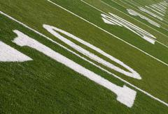 football field ten yard line to infinity - stock photo