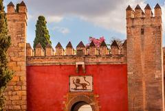 red front gate alcazar royal palace seville spain - stock photo