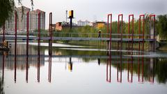 Stock Photo of red bridge reflections shanghai suburbs