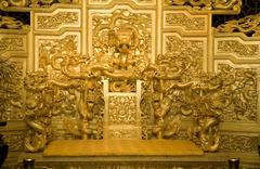 Chinese golden emperor's throne with dragons reproduction Stock Photos