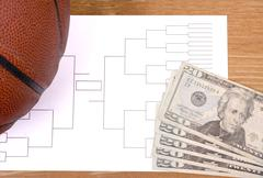 March madness basketball bracket and fanned money Stock Photos