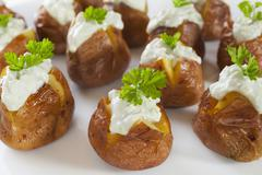 Mini baked potatoes with blue cheese dressing. Stock Photos