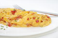 french omelette with red peppers - stock photo