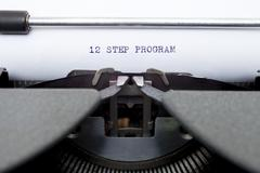 12 twelve step program typed on an old typewriter - stock photo
