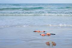 skinny dipping orange bikini on beach - stock photo