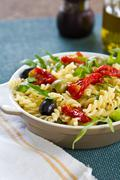 Fusilli with sun dried tomato salad - stock photo