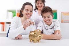 happy family with piggybank - stock photo