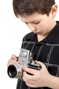 young boy with old vintage analog slr camera - stock photo