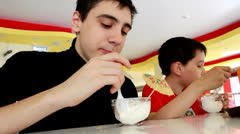 Boys eating ice cream - stock footage