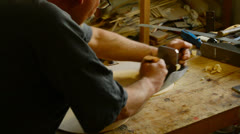 Luthier working in a flamenco guitar Stock Footage