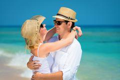 Loving couple on a clean blue sea Stock Photos
