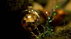 Golden bauble decoration on a christmas tree Stock Footage