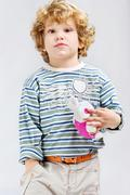 Young model with his toy Stock Photos