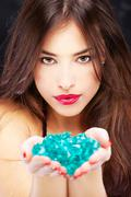 Woman with blue rocks Stock Photos