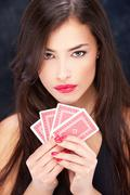 Pretty woman holding cards Stock Photos