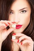 young woman holding dices - stock photo