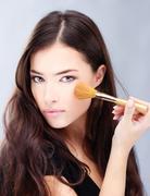 woman holding powder brush - stock photo