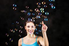 Happy girl and soap bubbles Stock Photos