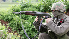 Soldier Changing AK47 Magazine in Grassland 02 - stock footage