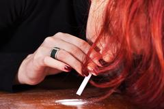 Woman and drugs Stock Photos