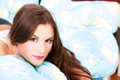 Girl in bedroom Stock Photos