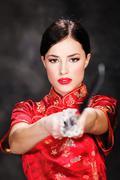 Pretty female katana warrior Stock Photos
