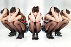 Woman between two mirrors Stock Photos