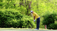 Young golfer tees off Stock Footage