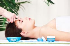 Forehead massage Stock Photos