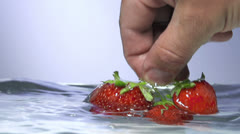 Strawberry in water splash Stock Footage