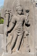 Stock Photo of female deity on relief carving in buddhist temple, indonesia