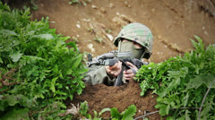 Soldier Jumping Into Cover 03 - Front View Stock Footage