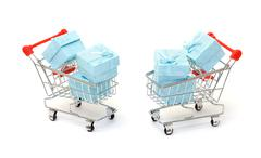 Cyan gift boxes in shopping carts Stock Photos